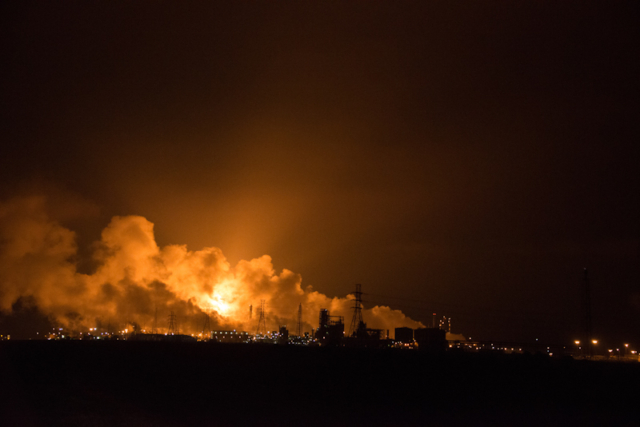 Oil refinery flaring at night in Brazoria County TX